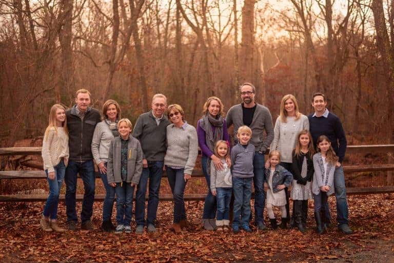 Family photograph during the fall illustrating how to get large groups in focus