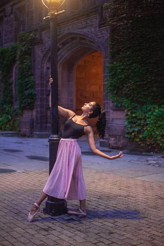 Picture of a ballet dancer shot in the dark below a street light